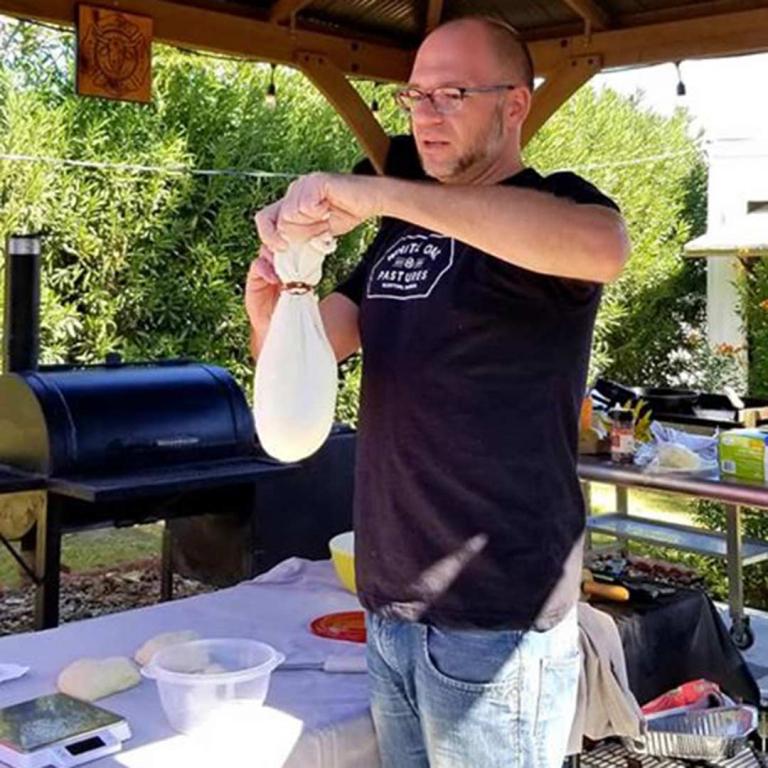 Kent demonstrating ricotta cheese