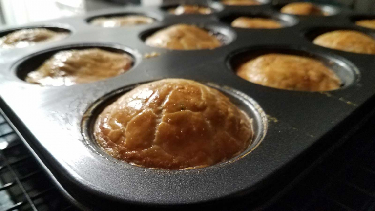 Pork pies hot out of the oven.